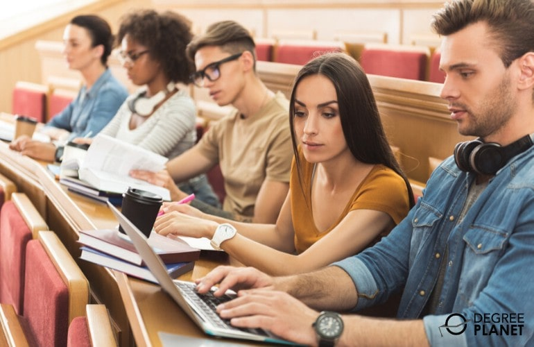 college students studying together in university classroom