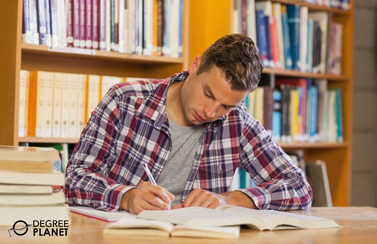 college student studying in library