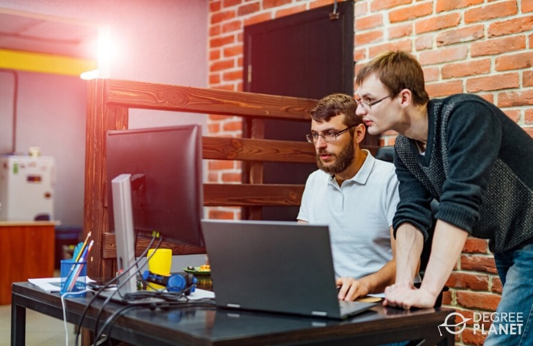 Software Developers working together in the office