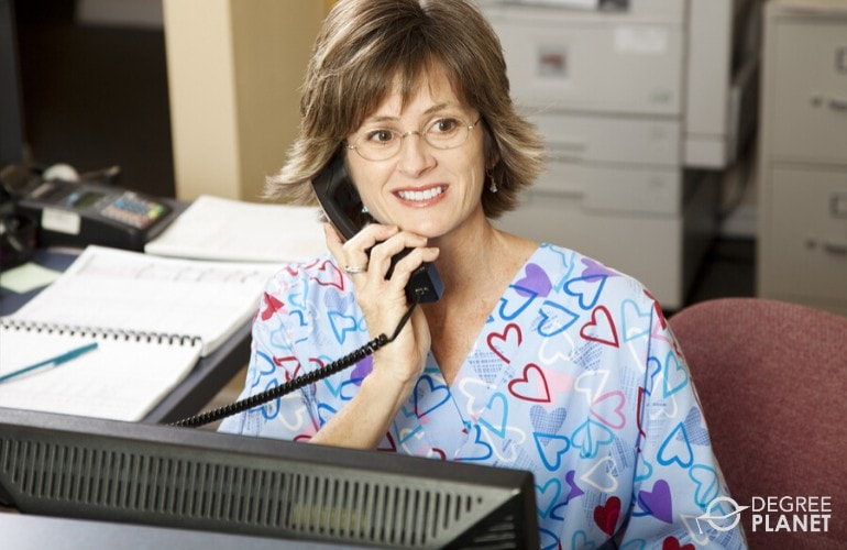 hospital secretary talking to a client on the phone