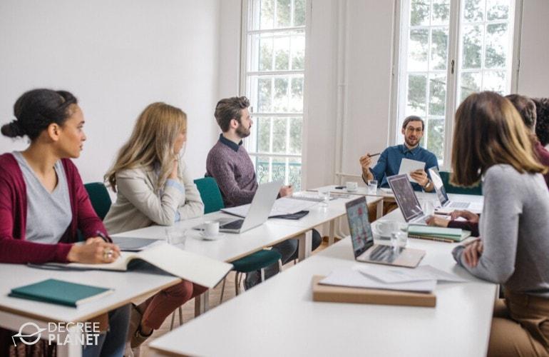 web developers listening to speaker in a seminar