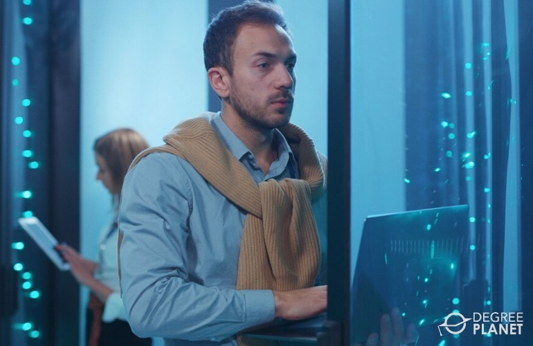Vulnerability Analyst checking data center