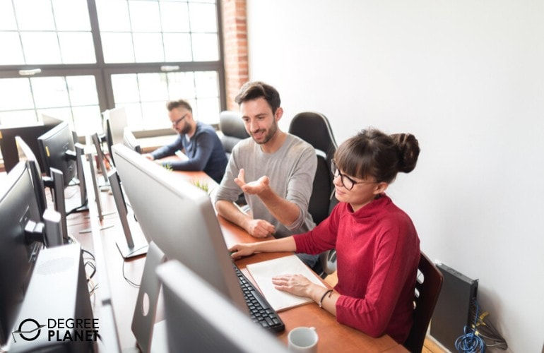 Web developers working together in the office
