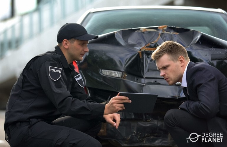 police officer showing video footage of accident to a detective