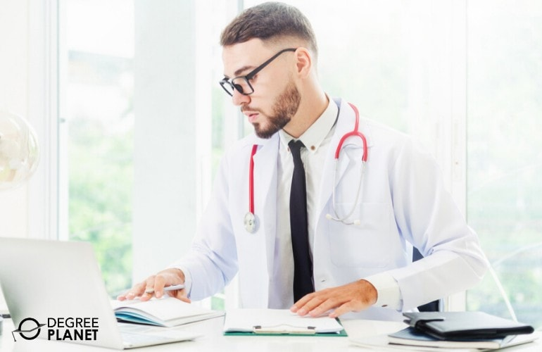 healthcare administration student studying in his office