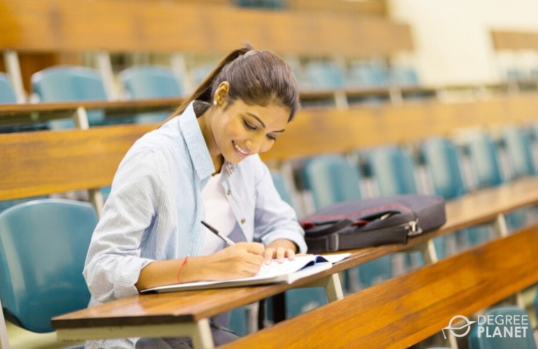 college student sitting in university classroom