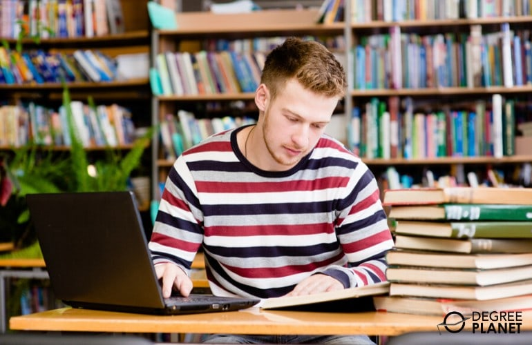 college student studying in the library