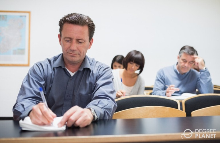 doctoral degree students studying in class