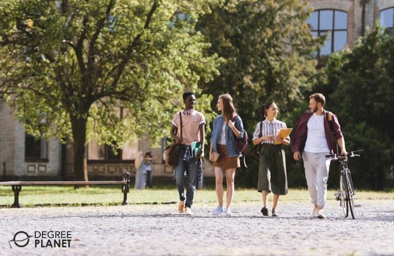 associates degree students walking in university