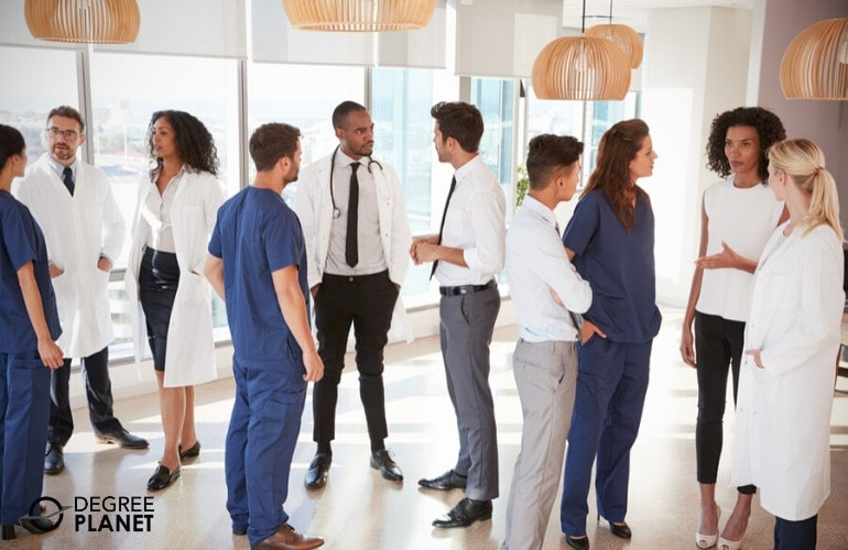 healthcare administrators meeting each other at a conference
