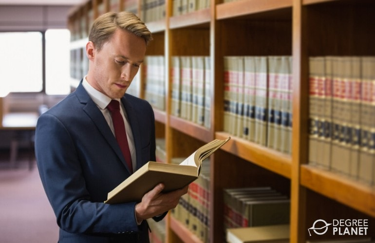 lawyer reading law books in library