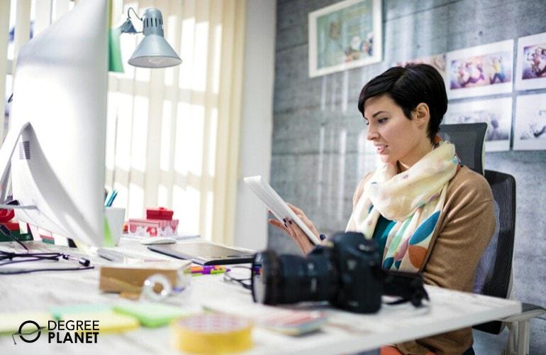 graphic designer working in her office