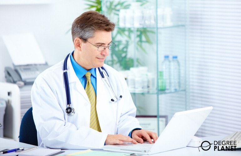 healthcare administrator studying in his office