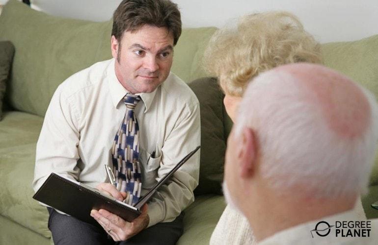 Social Worker talking to an elderly couple