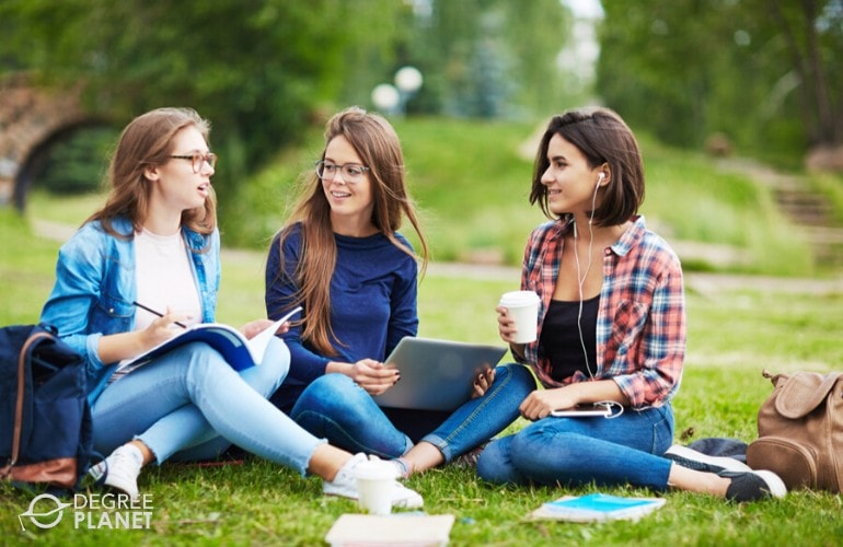 Bachelor's degree students studying on campus grounds