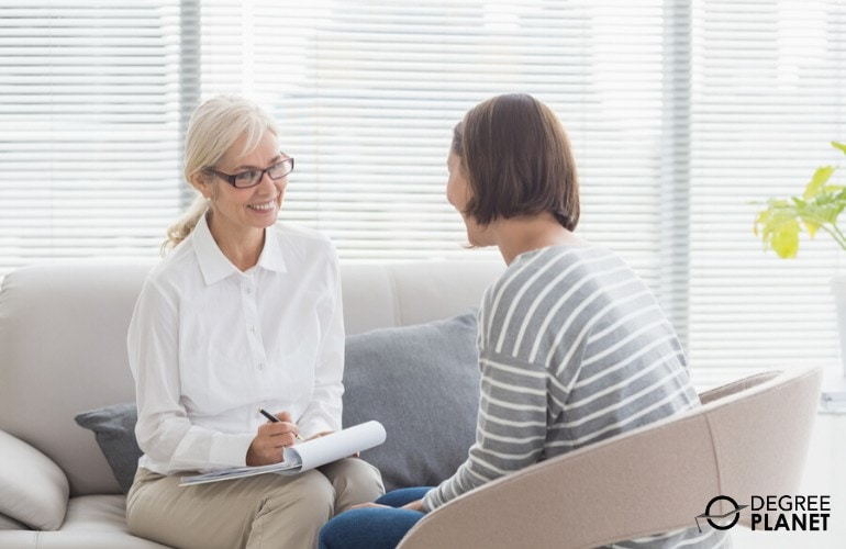 counselor listening to a patient during therapy