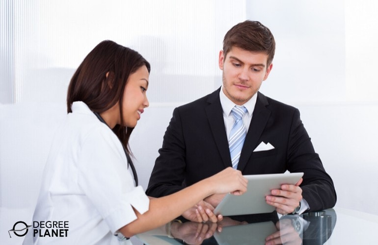 Management Consultant talking to a doctor