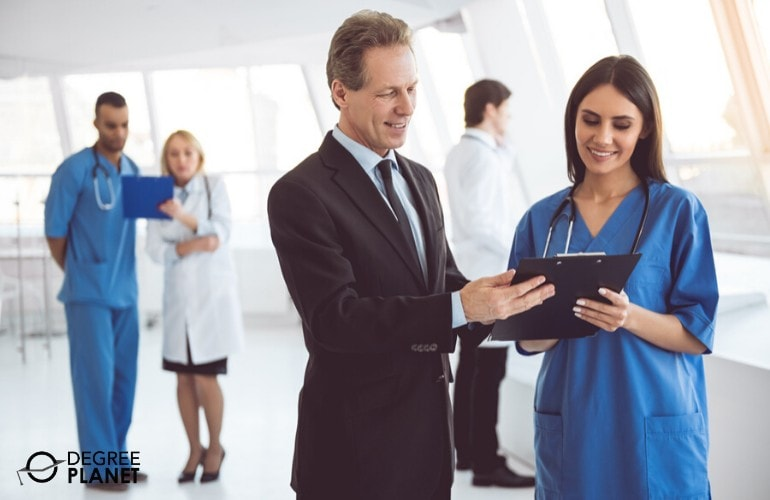 Healthcare administrator talking to a hospital nurse