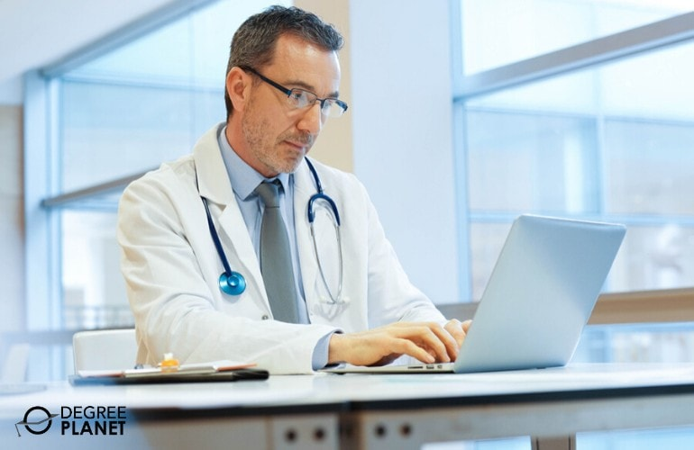 Healthcare Administrator working on his laptop