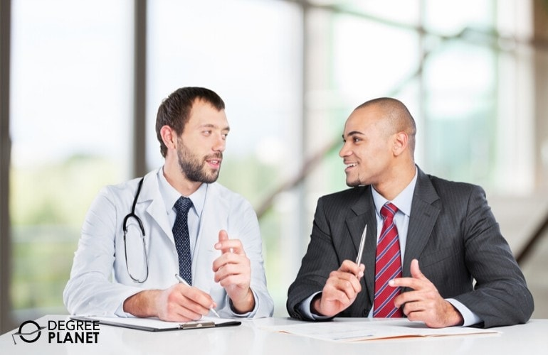 Healthcare administrator meeting with a doctor