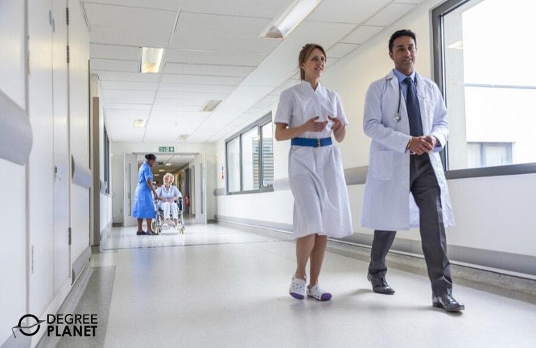doctor and nurse walking in hospital hallway