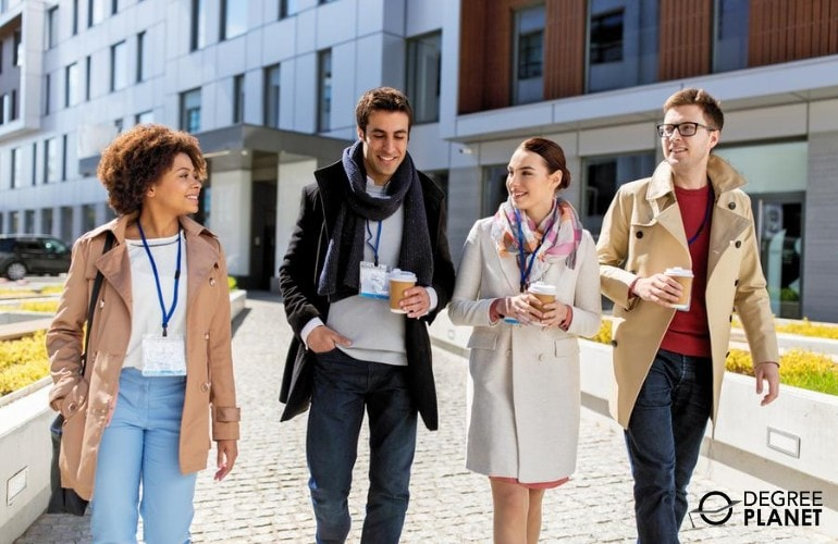 business professionals walking in university campus