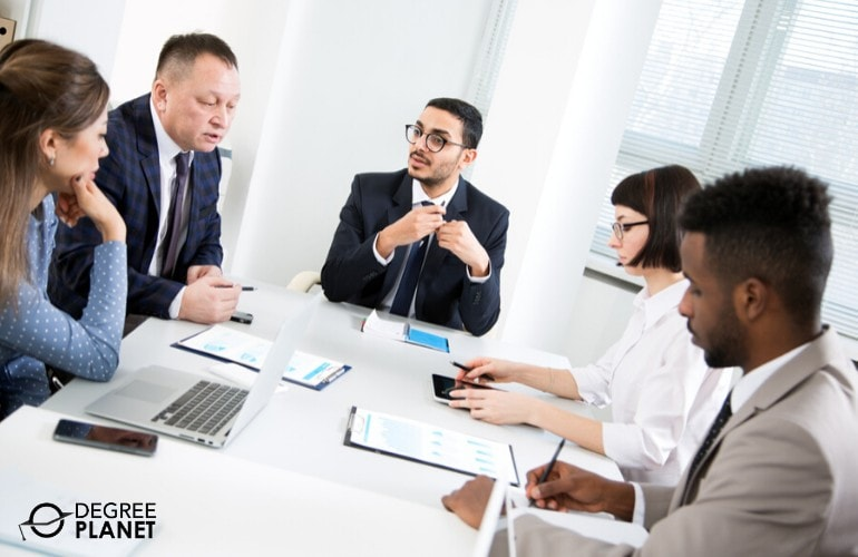 International Business Consultants in a meeting