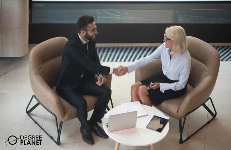 Compensation and Benefits Manager congratulating a new employee
