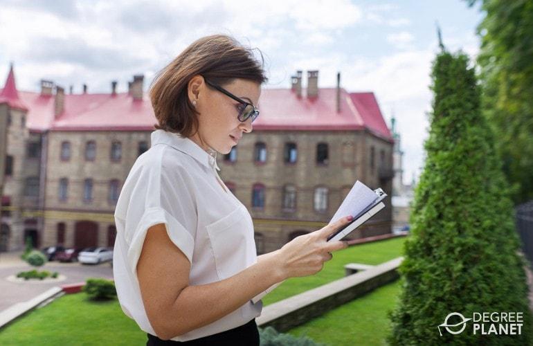 Education Administrator checking the school's perimeter
