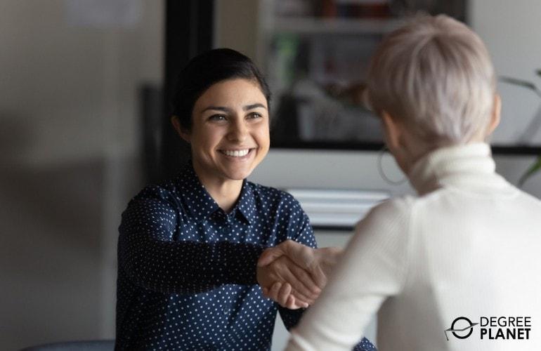 Human Resources Specialist congratulating a job applicant