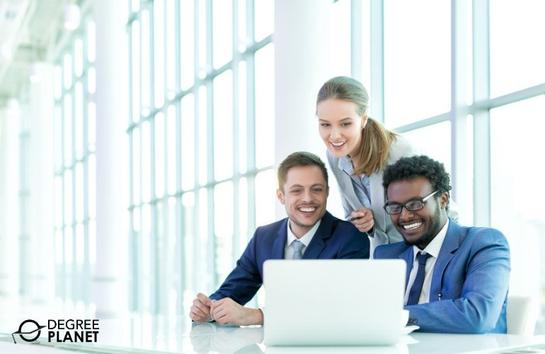 Group of Business Professionals happily working