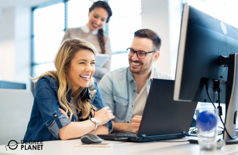 happy computer programmers working together in the office