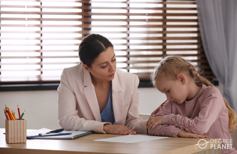 School Psychologist talking to a young child