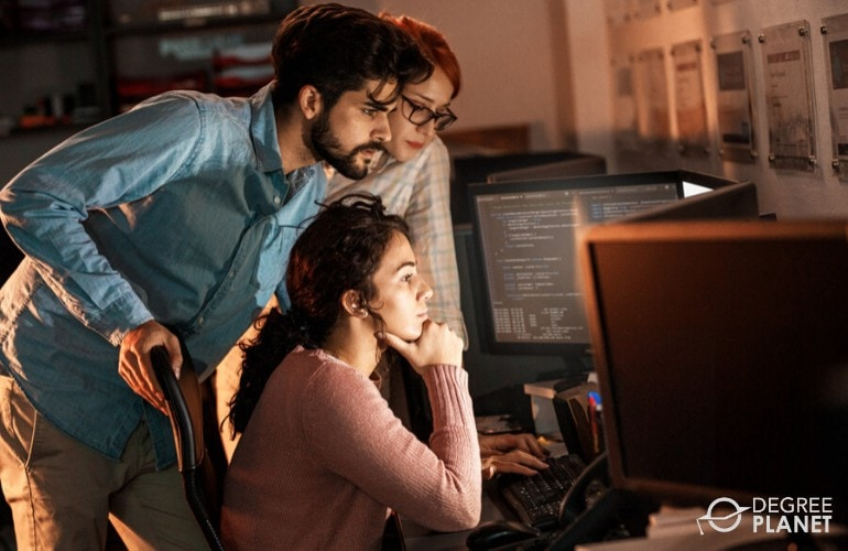 Software Developers working on a project together