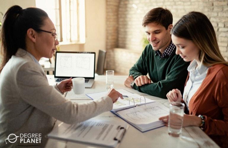 Personal Financial Advisor explaining Financial stuff to a couple