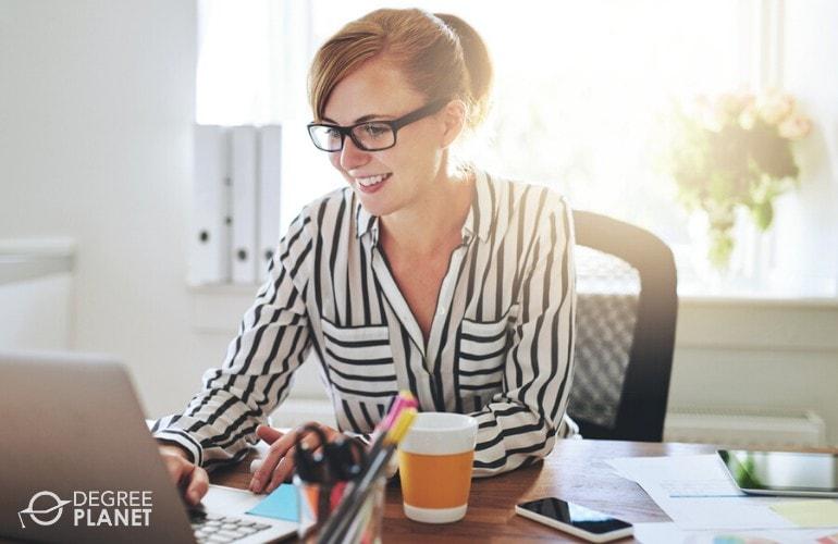 Web Designer working on her laptop at home