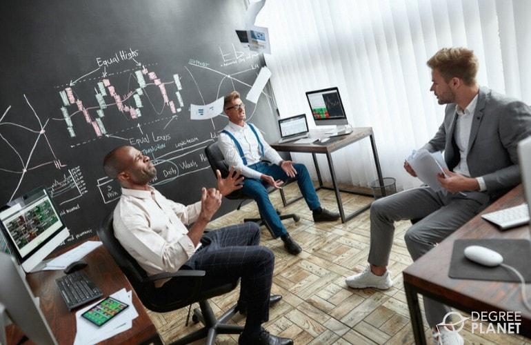 Business Analysts having an informal meeting