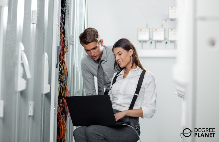 Computer Network Architects checking the data center