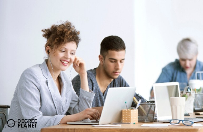 Social Media Marketing team working in the office