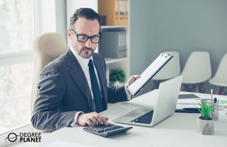 Bookkeeper reviewing documents in his office