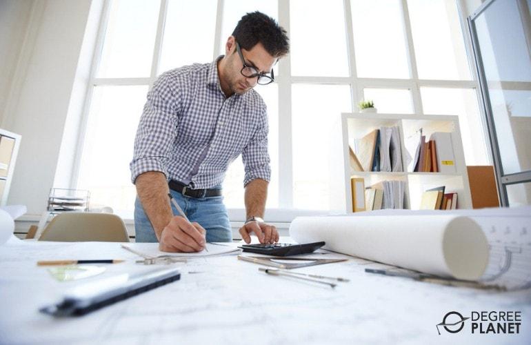 Civil Engineer working on his desk