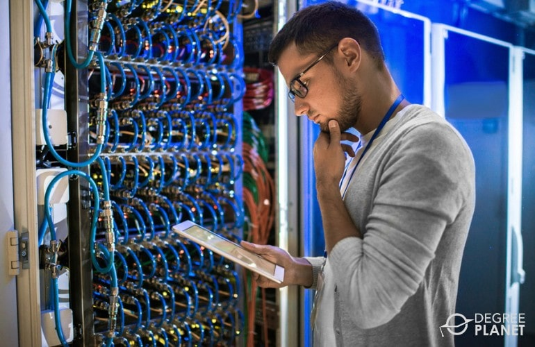 Computer and Information Research Scientist checking cables in data center
