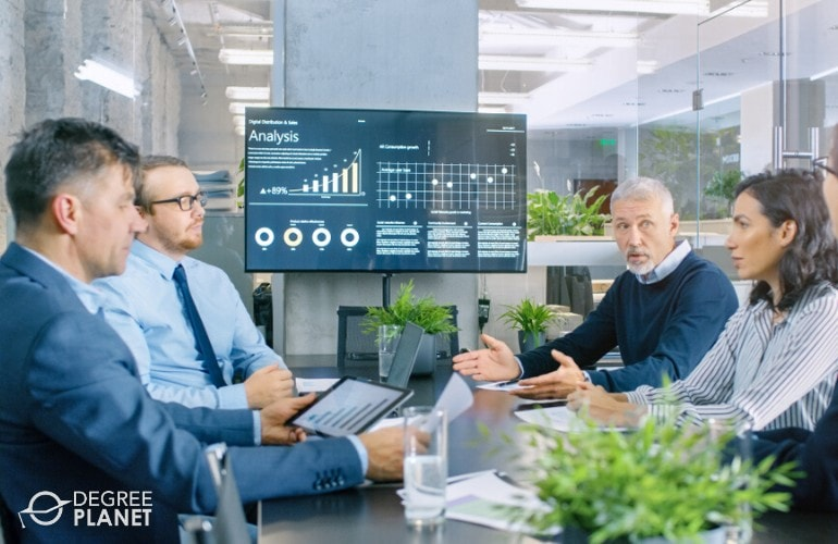 Computer and Information Systems Manager in a meeting