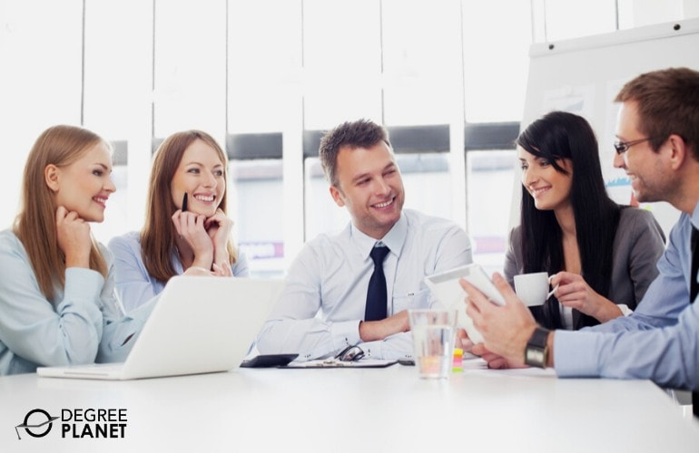 Compensation and Benefits Managers in a meeting