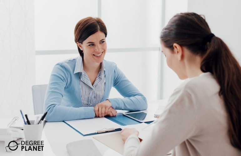 Human Resource Manager talking to a new employee