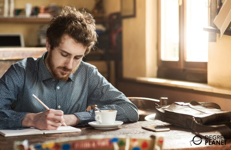 newspaper writer working in a cafe