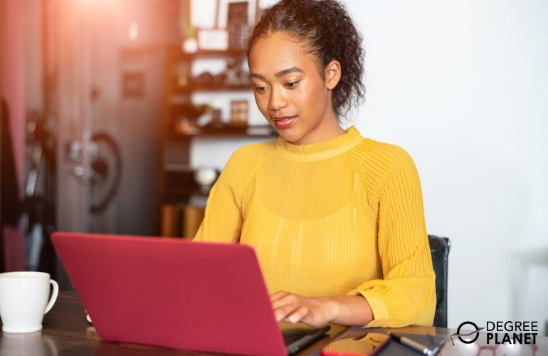 Engineering Associate's Degree student studying on her laptop