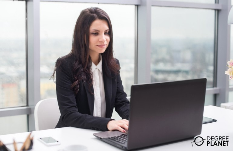 Health informatics professional working on her laptop