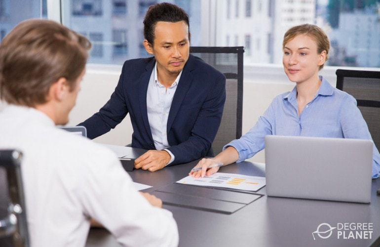 Human Resources Specialists interviewing a job applicant