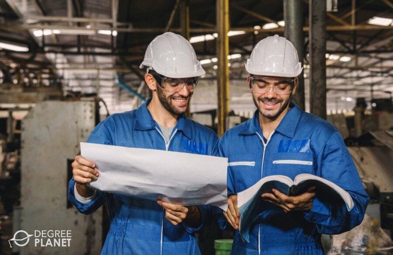 Mechanical Engineers looking at the plan in a construction site